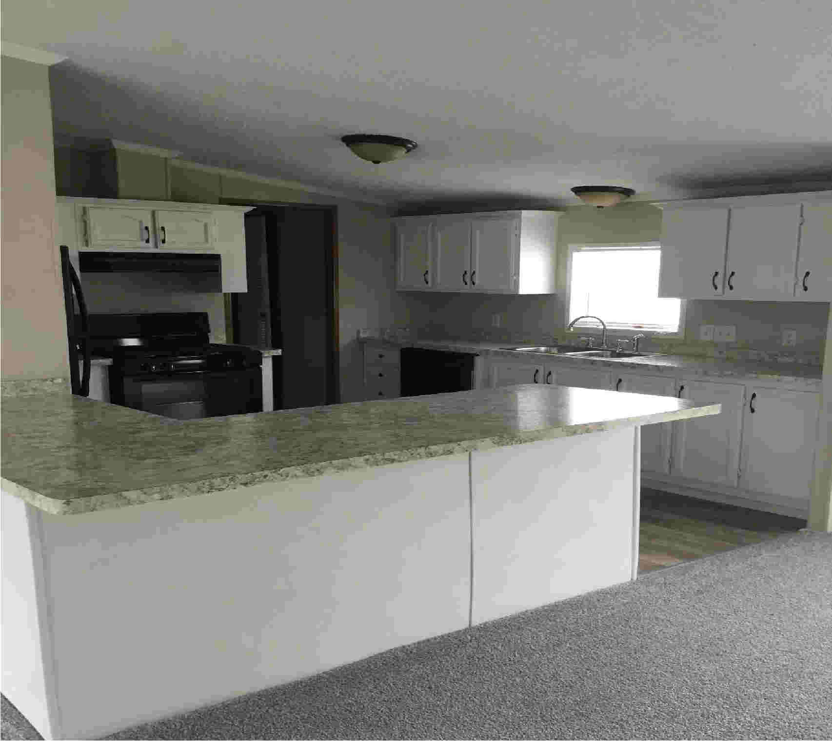 mobile home kitchen after refurbishment and repair