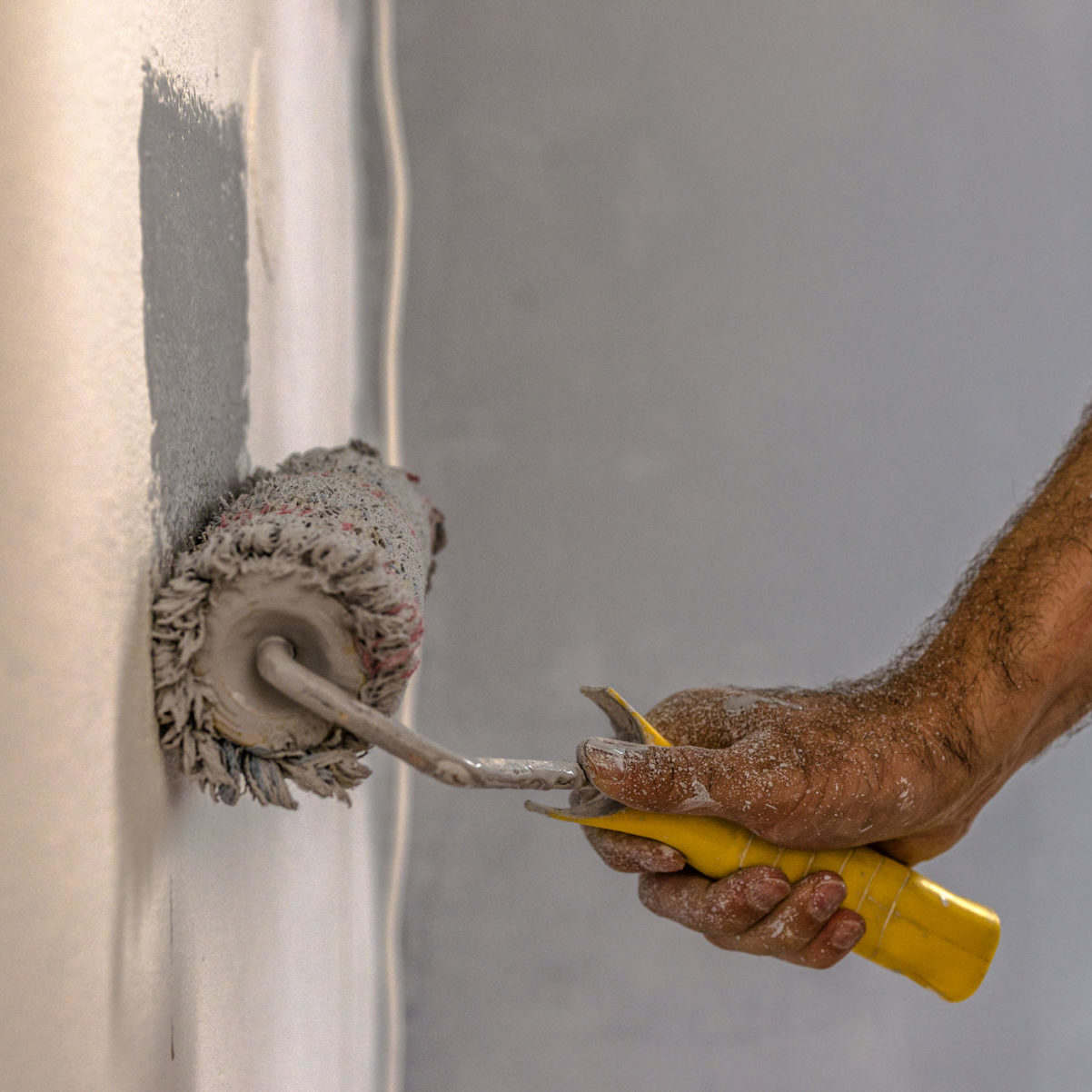 mobile home contractor painting wall